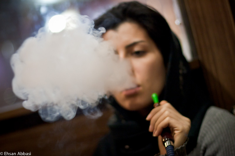 An Iranian female hookah smoker