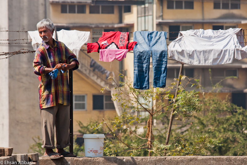 Washing laundry in the street