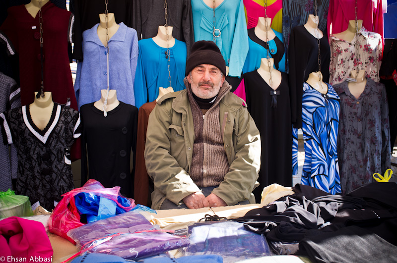 Clothes salesman at Jom'e Bazaar